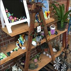 This Do-It-Yourself Garden Center Ladder Display is both home-made and ladder-based. And because it is triangular in arrangement, stable in the extreme. Ladder Display, Ladder Decor, Store Fixtures, Industrial Chic, Earthy, Retail, Homemade, Wood, Garden