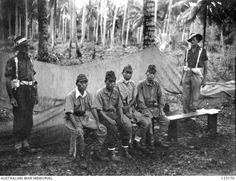 Four Japanese officers awaiting trial for war crimes at Labuan Island, December 1945. AWM 123170
