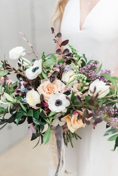 wedding bouquet with anemones - photo by Holly Von Lanken Photography http://ruffledblog.com/romantic-modern-minimalist-wedding-inspiration