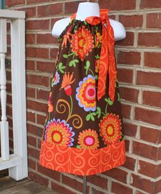 Pillowcase dresses!! So cute, so versitile. With endless fabric and ribbons to choose from, I hope to make a bunch of these. Ella needs one for every occasion!! I bought a pattern off of Etsy!