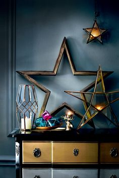 Lots of Christmas candles in star candle holders means a festive glow. For more like this click the picture or see www.redonline.co.uk