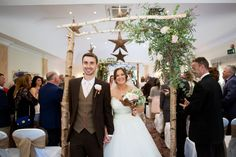 Branch archway and hanging wicker stars at Careys Manor Hotel Wedding.