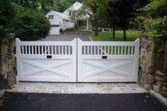 Automated white wood driveway gate