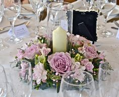 Memory Lane roses, freesias, anemones, gypsophila and a little mixed foliage. The anemones are available from the Winter through to the Spring but for Summer - Autumn brides who love the look, the lisianthus is a great substitute. Note candle is in hurricane vase. Looks great!