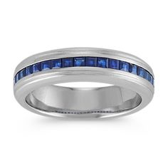 Choose a ring with regal elegance and a refined style that he will cherish forever. This ring features 18 square cut traditional blue sapphires, at approximately 1.14 carats total weight, each hand-selected for exceptional color and channel-set with an outlining satin finish. The ring is crafted of quality 14 karat white gold and is 6mm wide.