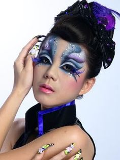 Vibrant artistic blue and purple fantasy make-up accented with crystals.