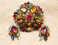 Juliana DeLizza Elster Rivoli Heliotrope Brooch Pin and Earrings are designed with oval, marquis, and round shaped rivoli crystals and aurora borealis cabochons.  All cabochons are faceted and prong s