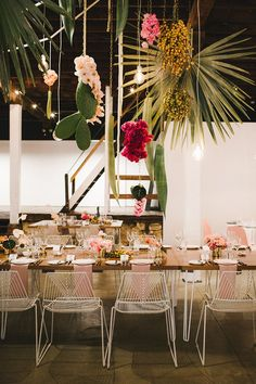 This tropical Aussie wedding has cacti chandeliers! #aussiewedding #tropical #palmsprings see more: https://ruffledblog.com/tropical-industrial-wedding-cacti-chandeliers