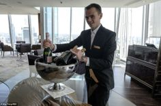 A member of staff places bottles of champagne in an ice bucket inside the restaurant and l...