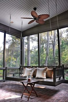 We love how this modern screened in porch allows you to enjoy nature no matter the season or weather. Check out other relaxing porch design ideas. Small Screened Porch, Screened In Porch Furniture, Screened Porch Designs, Screened Porch Decorating, Small Porches, Porch Windows, Porch Fireplace, Building A Porch, Building Homes