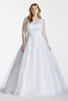 You'll be a vision in white (or ivory) in this tulle ball gown with a lace illusion bodice. This lovely dress has 45 expertly detailed yards of fabric with lace appliques, boatneck,three-quarter sleeves, and a sweep train.  David's Bridal Collection - Plus Size.  Also available in Regular, Petite, Extra Length and Plus Size Extra Length. Check your local stores for availability.  Sweep train. Fully lined. Imported. Back zipper. Dry Clean only. Cherish your wedding dress forever with