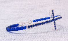 The color of this bracelet is gorgeous! Deep Sapphire Blue rows of rhinestones on the silver tone cross and then matching glass pony beads. I used memory wire for it to keep its shape nicely. Great gift idea!  Fits up to a 7 to 7 1/4 inch wrist  $12.00