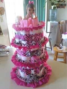 pink and black zebra diaper cake: pink and black zebra diaper cake  I made 3 tiers and I used paper towels and paper plates.