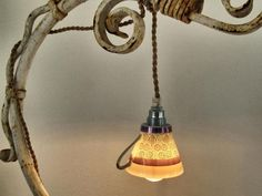 pendant lights and chandeliers made with tea cups and pots