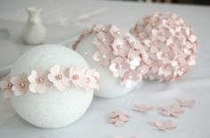 Perfect paper pomanders for showers, wedding, gathering etc.  Step 1. You'll need to punch 180-200 of the hydrangea petal shapes, which will take around a sheet and a half of 12×12 scrapbook pape