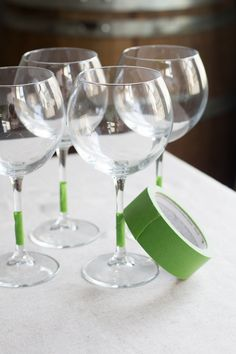 Prepping wine glasses for chalkboard paint.