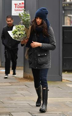 Suits actress Meghan, who is said to have practically moved into Harry's Kensington Palace cottage, looked chic in Hunter wellies and a Barbour coat for the occasion