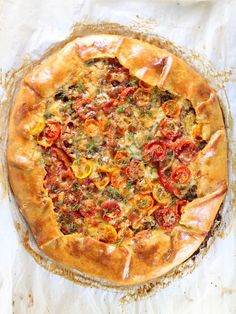 Three Cheese Tomato Thyme Galette Recipe:  A homemade crust layered w/heirloom tomatoes, shallots, thyme, Parmesan, asiago & sharp white cheddar cheese.  #tomatoes http://tasteandsee.com