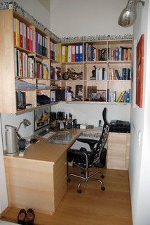Walk in closet office- good use of space, not our style