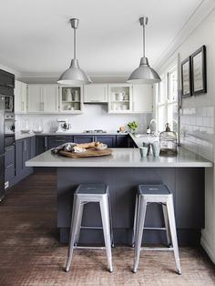 Contemporary white and gray kitchen with two-tone cabinets: White upper cabinets and ...