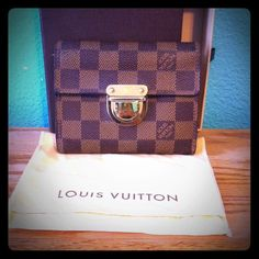 Authentic Louis Vuitton Damier Koala Wallet Originally purchased in 2008 at Fashion Show Mall in Las Vegas. They dont even make this style anymore so this is a piece of LV history!  Has 9 card slots, large bills slot, and zippered coin section. In Excellent Condition, with very light signs of wear on hardware. There is a slight stain by the zipper, but it's hard to see it because of the dark checkered pattern. Comes with dust cover and slide box, so can also make a great gift. Only selling…