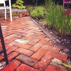 Recycled chimney brick patio. All you need is a rubber mallet and sturdy knees!