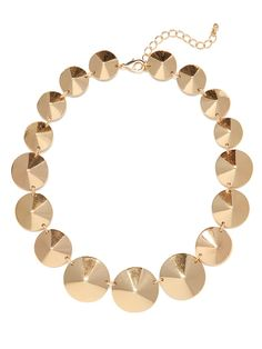 Were mad for the marriage of tough-chic edge and classy elegance in this striking necklace. It features oversized cone studs, cast in gorgeous gold.
