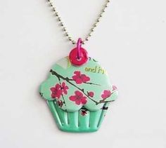"soda can jewelry, saw this at a craft show had to figure it out on my own, use a sticky foam or make your own with a ""sticker"" maker or good glue, glue down a clean, cut open can, use a sizzix to cut your shape, add an eyelet and a chain, or a pin back, or a magnet"