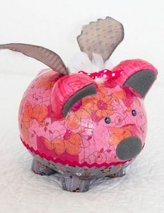 Save up money in style with this DIY upcycled piggy bank! You can get really creative and add little wings too. :)