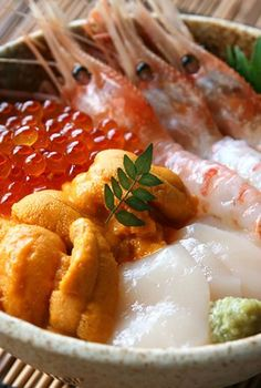 Sashimi Combinations that compliment each other in taste.  Uni (Sea Urchin), Ikura (Salmon Roe), Sweet Shrimp and Squid