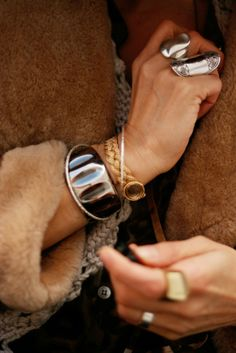 wrist & finger adornment on Jennine Jacob of the-coveted. love that braided gold watch.