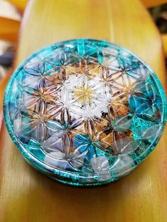 """This listing is for one chrysocolla and rose pedal Flower of Life Orgonite     Here are some common uses/benefits for Orgonite:     -Eliminate EMF (smart meters, wifi, 4g electro-smog)  -Transmutes deadly energy to positive life force energy  -Enhance plant growth  -Structure food and water-food keeps longer near orgonite  -Balance the environment  -enhanced psychic ability  -helps anchor in higher dimensional energies    Dimensions: 3""""  x  3/4"""" deep      This is a circular shaped piece with…"""