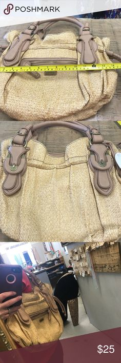 Jessica Simpson purse Jessica Simpson leather and straw like handbag. Brand new with tag. One of the pieces is missing as shown in the picture. Retail on price tag is $98. Comes from a smoke free home. I purchased and forgot I had it. I don't have a use for it anymore. Jessica Simpson Bags Shoulder Bags