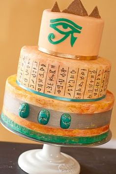 Ancient Egyptian-Themed Party - Cake decorated with edible marker hieroglyphics and cut eye/molded scarabs out of fondant. Perfect for the mr's bday cake since he loves egyptian stuff so much