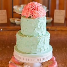 Coral and mint wedding cake with flowers on top.  Photo: Untamed Heart Photography. | http://emmalinebride.com/color/coral-and-mint-wedding/
