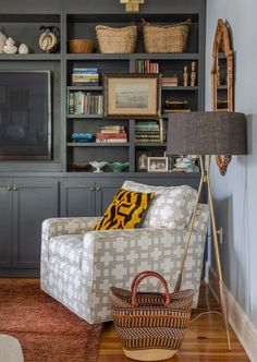 tv in bookcase- grey! like the picture hanging on front as well (and lamp)- plus chair in front, just like I plan to do!