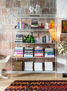 A mean shelfie in the Brooklyn loft of Jonathan Adler's Director of Interiors, Benjamin Brougham, featured on Design Sponge. Ben uses the Jonathan Adler Ceramic Horse as a topper for his bookshelf.