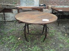 Rustic round table made from ash and base made from old leaf springs off a boat trailer