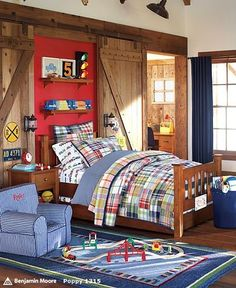 barn doors behind bed that maybe slide to cover his windows at night? Wonder if that could work, hmmm.....
