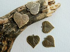 Small Brass Heart Leaf Charms  Antique от BeadsandmorebyYashma, £3.00