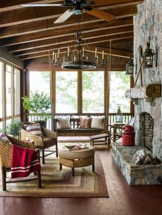 a Cabin Where Time Stands Still A South Carolina Screened in Porch featured in Country Living MagazineA South Carolina Screened in Porch featured in Country Living Magazine House Design, House, House With Porch, Sunroom Decorating, Cabin Decor, Lake House, Rustic Living Room, Rustic Porch, Cabin Porches