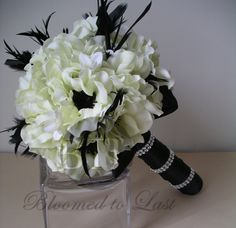 Hollywood Glam wedding bouquet decked out in black & white anemones, black feathers and accented with rhinestones.
