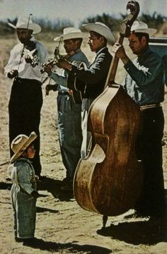 justenoughisplenty:  Musicians entertain a crowd, including a pint-sized boy in Santa Bárbara, near Texmelucan in Tlaxcala. National Geographic - October, 1961