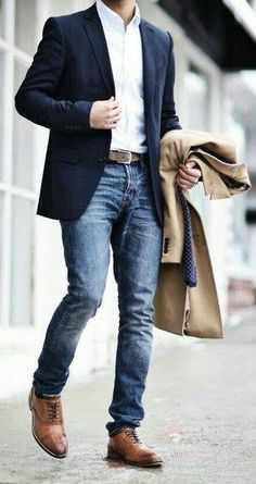 Business Denim Outfit for men with Blazer or suit jacket with white denim and a khakhee overcoat in hand.