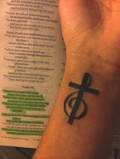 Treble clef cross tattoo.