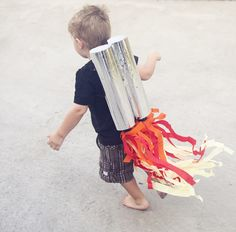 Who needs party hats when you've got rocket packs?  Coolest idea (and EASY DIY) for space-themed birthday party.
