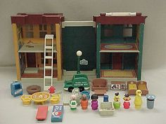 Sesame Street house.  There was a chalkboard in the middle.  It folded up and could be carried by a handle.  I carried this all over the place!