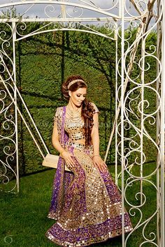 Vermillion Collection - Purple and gold mirror work lengha ideal for a Sangeet or a wedding reception.