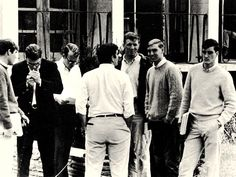college guys in the early 1960s. Shetland sweaters, OCBDs, khaki pants.