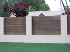 Rendered block fence with timber insets